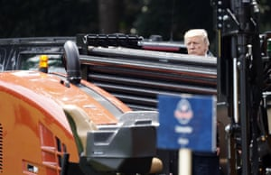 Trump looks at a Ditch Witch, made in Oklahoma