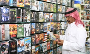 Saudi Abdul-Wahhab al-Sanyour, who used to be a movie projectionist when Saudi Arabia allowed movies to be shown, is seen at his video store in Jiddah, Saudi Arabia, April 2006.