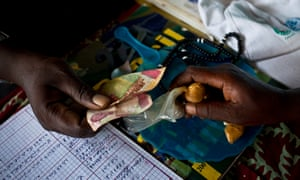 Mory Kaba, a traditional healer, sells herbs at his shop in Kissidougou, Guinea.