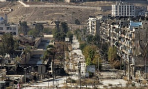 An empty street in rebel-held east Aleppo leads to a crossing point with the government-held neighbourhood of al-Masharka