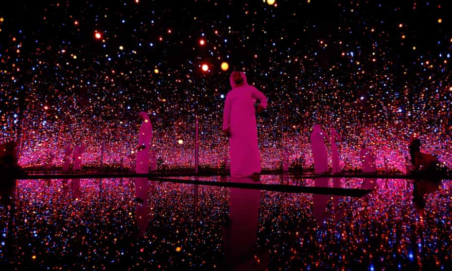 Visitors to a pre-opening exhibition at the Guggenheim Abu Dhabi walk through an installation by Yayoi Kusama
