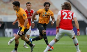 Wolves' Adama Traore surges forward.