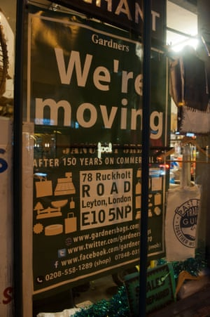 A 'We're moving' sign in the window of Gardners Market Sundriesmen shop