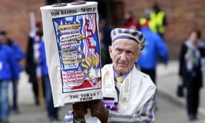 Personal triumph over the forces of evil … survivor Ed Mosberg carrying the Torah at the 2017 March of the Living between Auschwitz and Birkenau