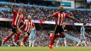 Defoe celebrates with his teammates as Sunderland battle back.