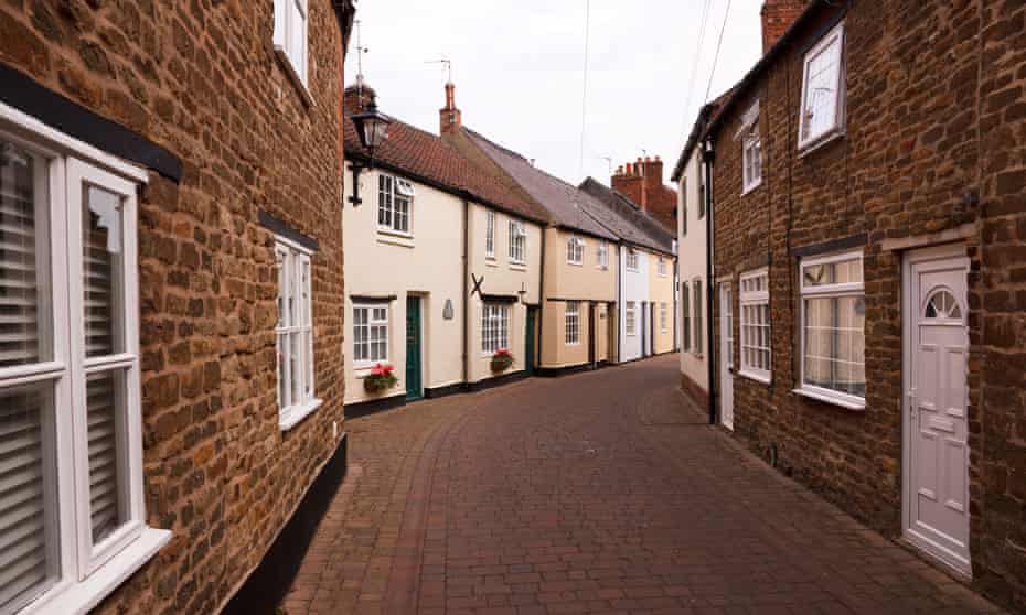 Terraced row of beautiful old painted English cottages