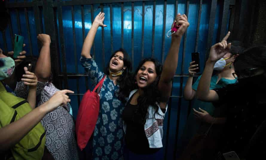 Activists Natasha Narwal, left, and Devangana Kalita shout slogans after being released from Tihar jail, Delhi, last month.