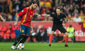 Sergio Ramos chips the ball past Norway's goalkeeper from the penalty spot to earn Spain a 2-1 victory at the Mestalla in Valencia.