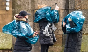 Tourists in Edinburgh struggle with Storm Dennis's high winds and rain