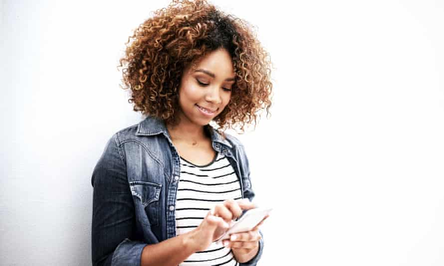 Young woman using her mobile phone