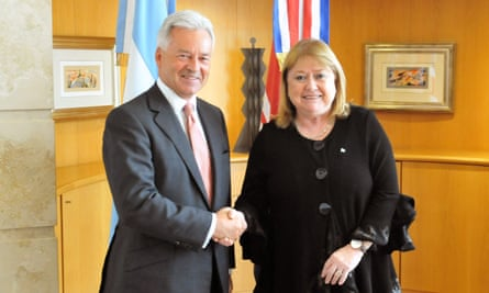 Sir Alan Duncan shakes hands with Argentina's foreign minister, Susana Malcorra, during a meeting in Buenos Aires.