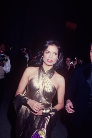 Bianca Jagger wearing a gold lamé dress, in New York, c1970