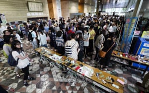 Local residents queue to charge their mobile phones in Sapporo
