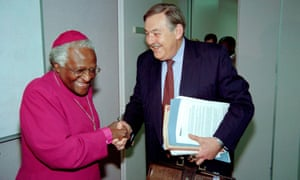 Botha shakes hands with Desmond Tutu at the Truth and Reconciliation Commission Hearings in Johannesburg in 1997.