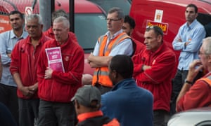 Royal Mail workers listen to a representative of the Communication Workers Union (CWU) in September.