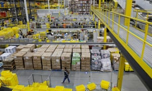 Amazon workers perform their jobs inside of an Amazon fulfillment center in Robbinsville, New Jersey, on 2 December 2019.