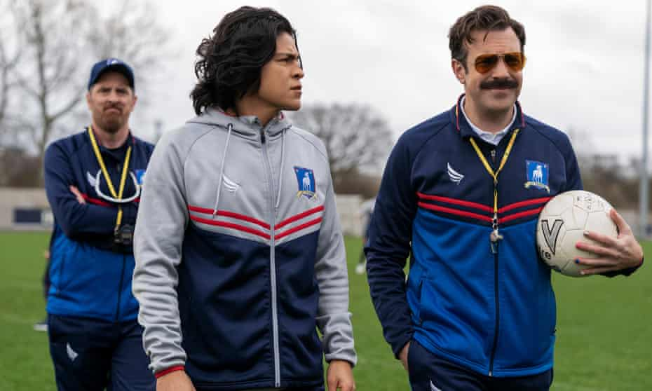 Back of the net ... Brendan Hunt, Cristo Fernández and Jason Sudeikis in season two of Ted Lasso.