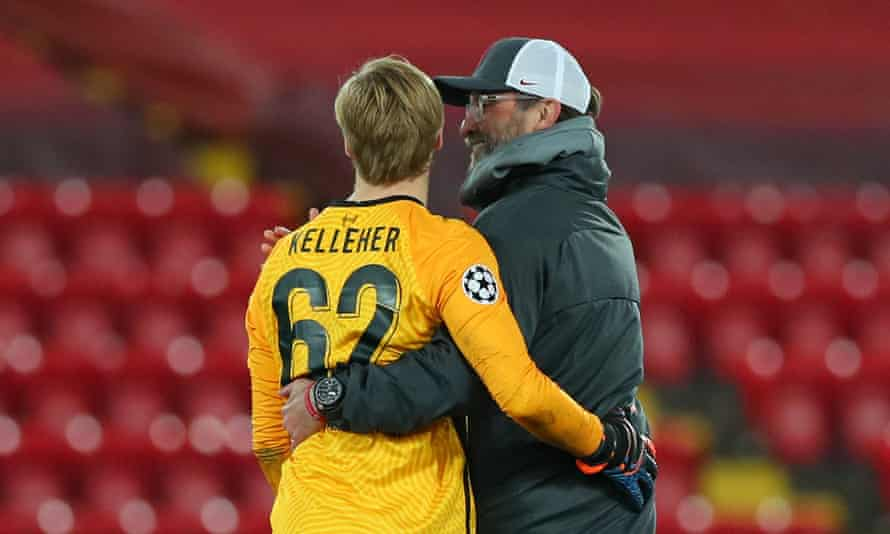 Jürgen Klopp gives Caoimhin Kelleher a hug at the end of the game.