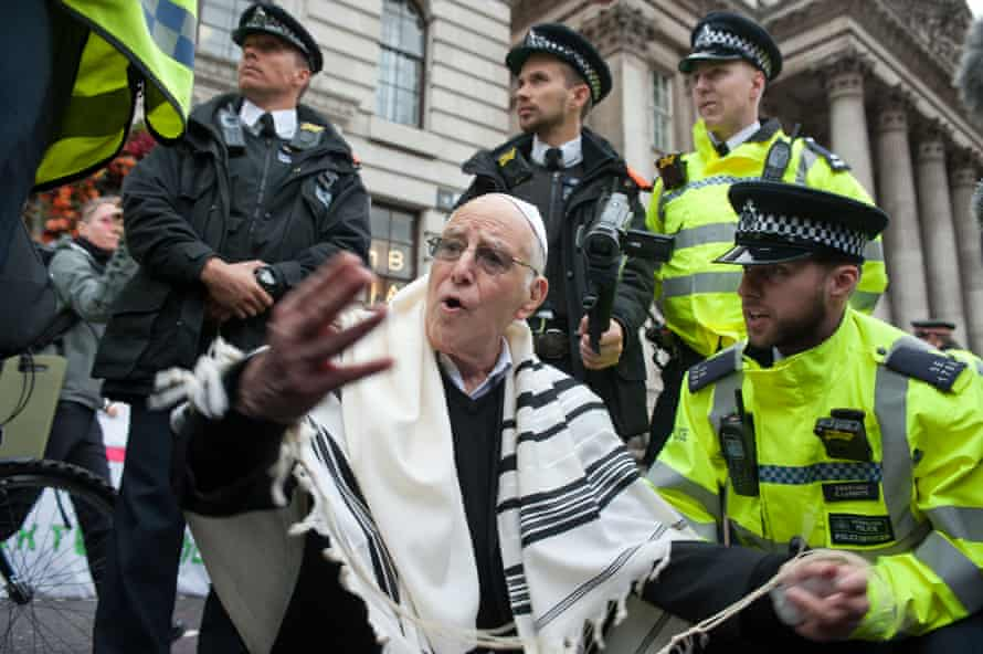 Rabbi Jeffrey Newman being arrested by police outside the Bank of England.