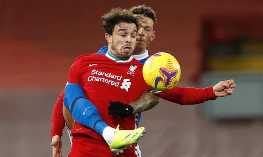 Liverpool's Xherdan Shaqiri and Brighton's Ben White compete for the ball.