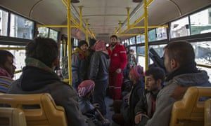 Syrian Red Crescent staff and people from east Aleppo on a bus during Thursday's evacuation operation.