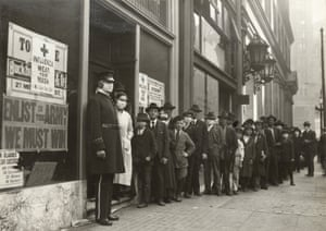 People wait in line to get flu masks to avoid the spread of Spanish influenza on Montgomery Street in San Francisco in 1918.