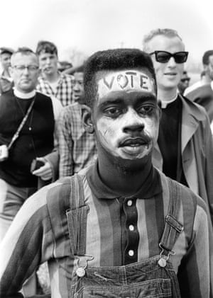 Bobby Simmons, who became known for this photo, takes part in the Selma to Montgomery march on 21 March 1965