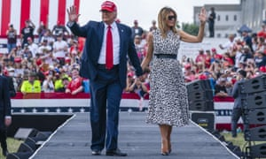 Donald Trump walks with Melania Trump in Tampa in October.
