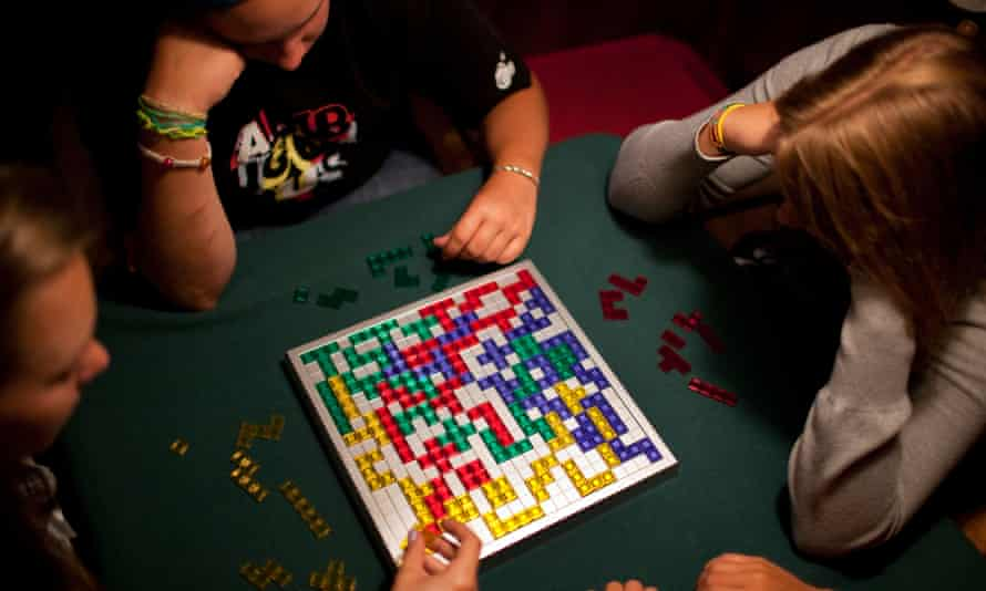 Children playing a game of Blokus