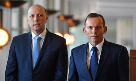 Former prime minister Tony Abbott (right) has agreed with Peter Dutton's view that South African farmers deserve 'special attention' for immigration to Australia.