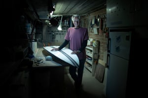 Surfboard repairer Barry 'Baz' Whiteman in his workshop under his house
