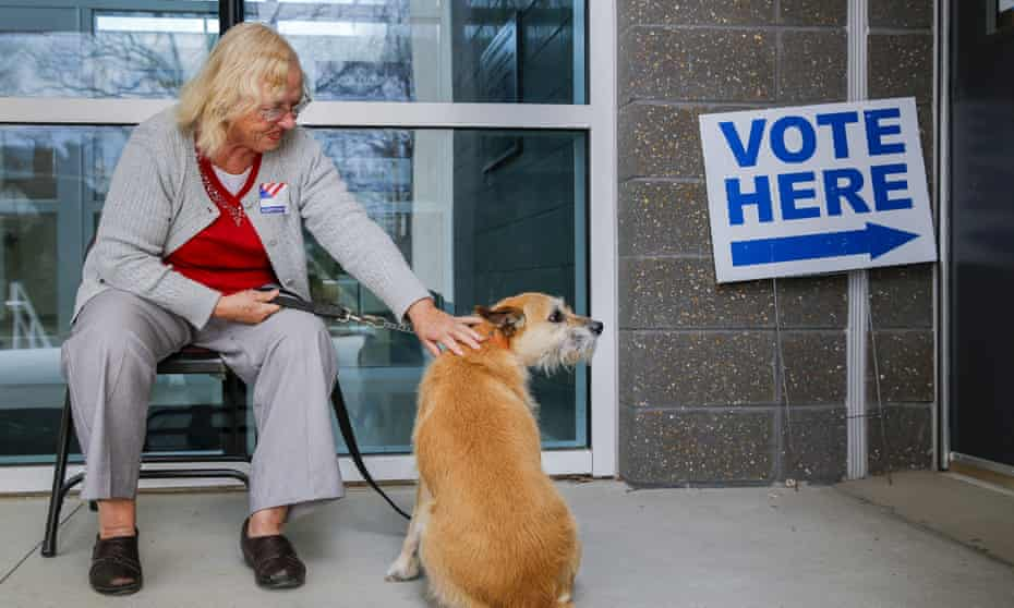 Super Tuesday votingepaselect epa05189413 Poll manager Adrienne Dowling looks after Jane Major's terrier mix 'Abby' while Major casts her ballot at Mary Lin Elementary School, during Super Tuesday US presidential primary voting in Atlanta, Georgia, USA, 01 March 2016. Twelve states are holding primaries or caucus across the United States. EPA/ERIK S. LESSER