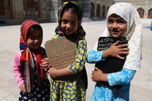 Herat, Afghanistan. Children learn to read the Qur'an at a mosque during the holy month of Ramadan