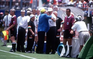 """Charlton is held by back as he strongly argues with a Fifa official after a dispute over water bottles in their 2-1 defeat to Mexico. He later said of the incident: """"It was a tough tournament and very hot out there in Orlando. My son John was trying to get water on to the players. But for some reason they wouldn't let us."""""""