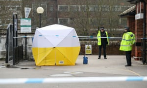 Police officers stand guard at a cordon on the roof of a Sainsbury's car park in Salisbury