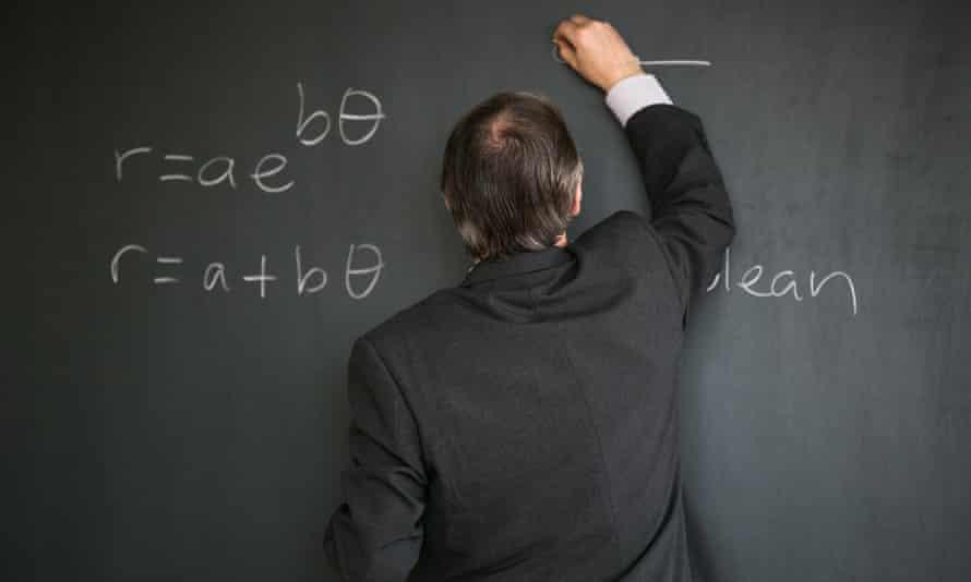 Senior mathematic professor writing on a board