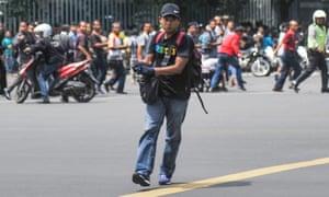 Unidentified man with gun