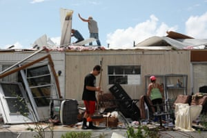 Olga Teakell and her family clean her mobile home