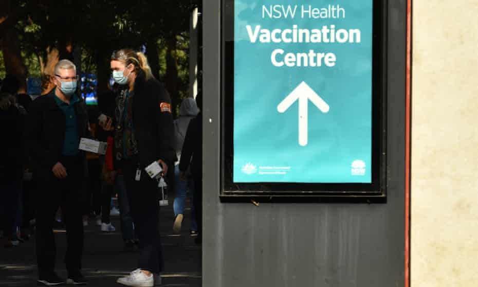 People line up for their Covid-19 vaccine at the vaccination hub at Sydney Olympic Park