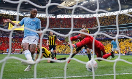 Raheem Sterling slots City's sixth past Heurelho Gomes.