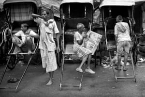 Rickshaw pullers wait for customers.