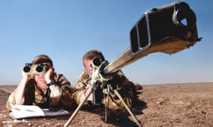 Royal Marine snipers from 42 Commando M Company Corporal Richie Mockler and Lance Corporal Nick Young test firing a Barrett .50 calibre sniper rifle at a range in Iraq.