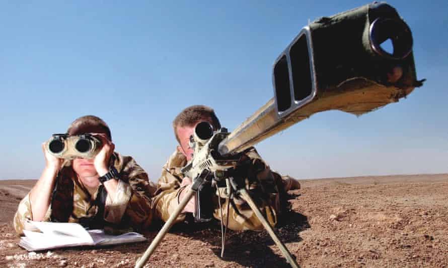 Royal Marines snipers firing a Barrett .50 calibre rifle.