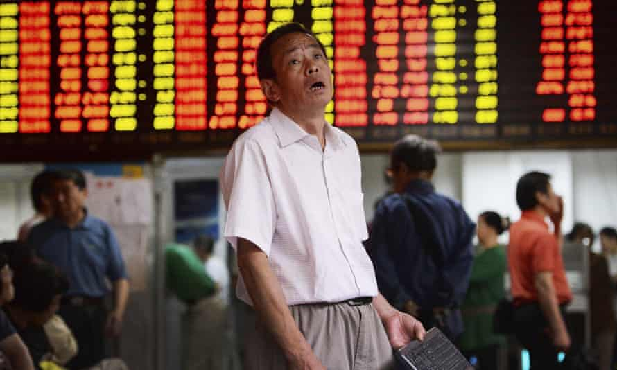 A man reacts to stock market falls in Shanghai.