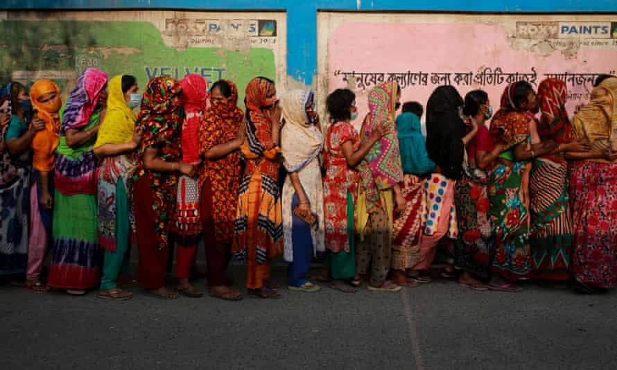 Women queue to collect aid during the nationwide lockdown in Bangladesh