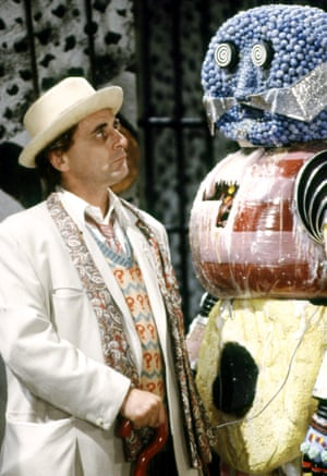 Sylvester McCoy as Doctor Who, with the Kandyman, a creation by Dorka Nieradzik oozing confectionery, for The Happiness Patrol, 1988.