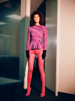 pink long sleeved frill on hem top, red trousers, boots and black gloves all from Balenciaga
