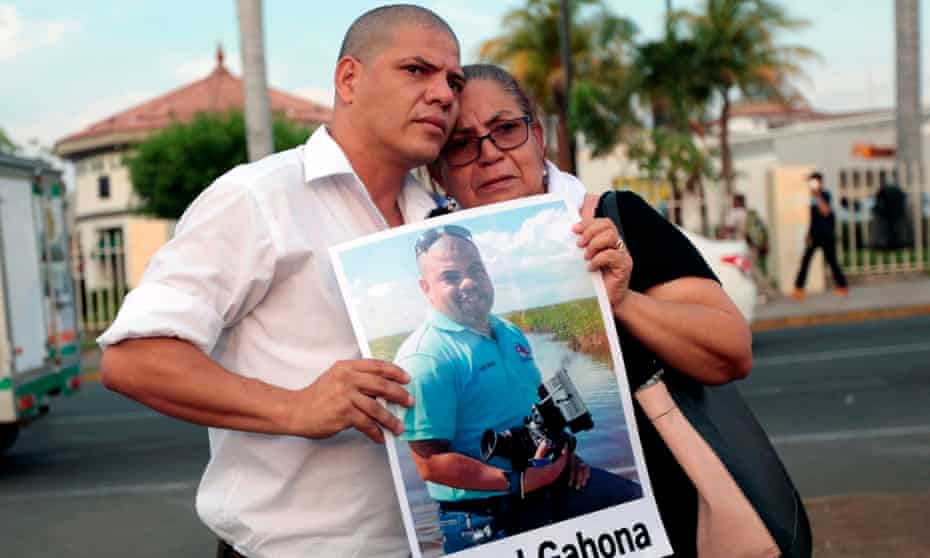 The mother and brother of journalist Ángel Gahona,who died while reporting on an anti-government protest in Bluefields, demonstrate in Managua earlier this month.