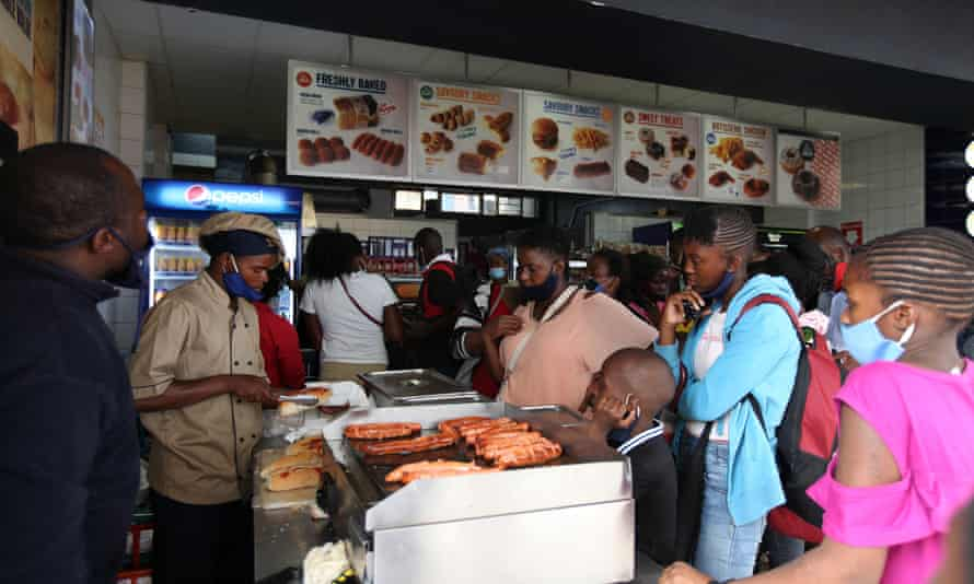A packed Harare fast food store on New Year's Eve.