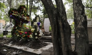 Crosses of fresh flowers adorn a new grave at Xilotepec Cemetery amid the new coronavirus pandemic, in Xochimilco, Mexico City, 27 July 2020.